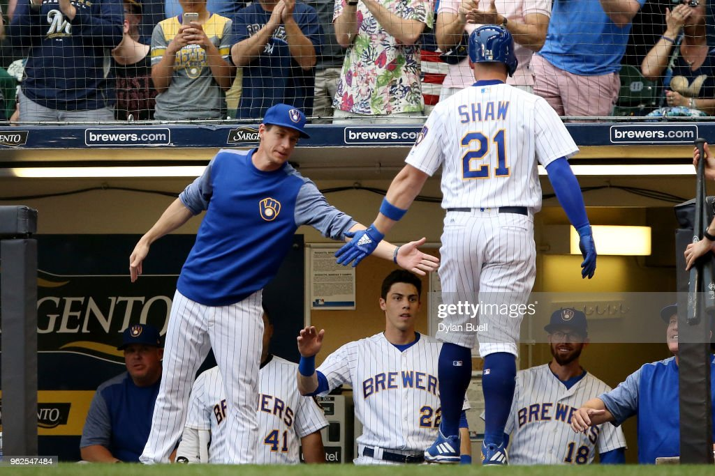 Manager Craig Counsell of the Milwaukee Brewers congratulates Travis Shaw #21 after Shaw hit a home run in the second inning against the New York Mets at Miller Park on May 25, 2018 in Milwaukee, Wisconsin.