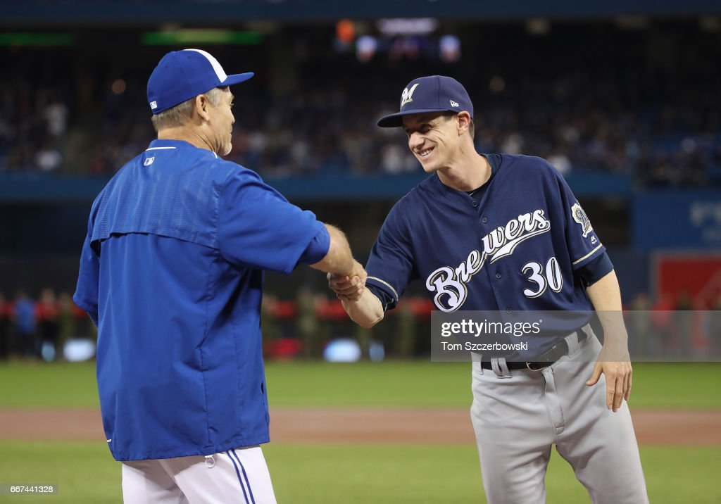 Manager Craig Counsell #30 of the Milwaukee Brewers greets manager John Gibbons #5 of the Toronto Blue Jays as starting lineups are introduced before the start of the home opener at Rogers Centre on April 11, 2017 in Toronto, Canada.