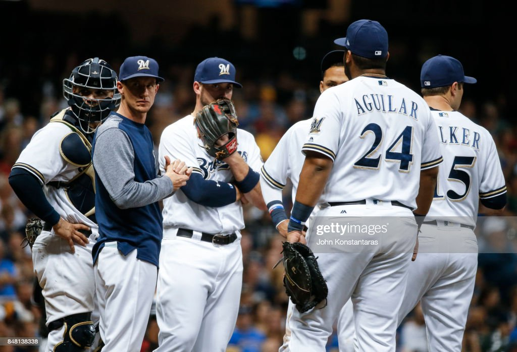 Manager Craig Counsell #30 of the Milwaukee Brewers makes a pitching change during the seventh inning against the Miami Marlins at Miller Park on September 16, 2017 in Milwaukee, Wisconsin. The Marlins defeated the Brewers 7-4.