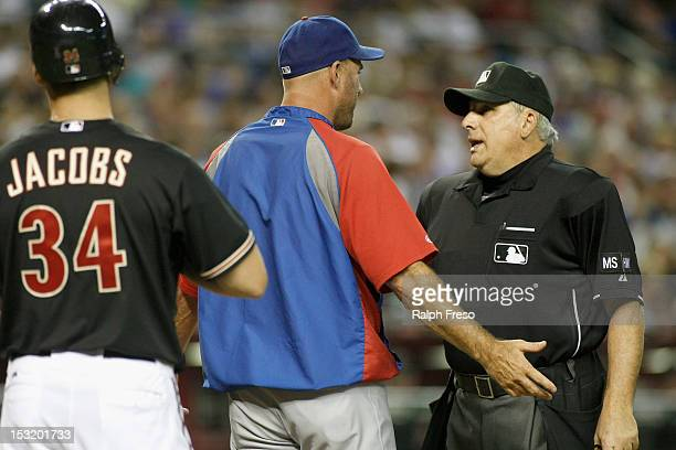 Manager Dale Sveum of the Chicago Cubs argues a call with home plate umpire Larry Vanover concerning batter Mike Jacobs of the Arizona Diamondbacks...