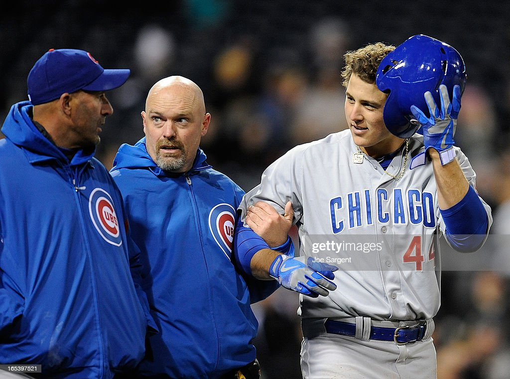 Manager Dale Sveum talks with Anthony Rizzo #44 of the Chicago Cubs after being hit by a pitch during the seventh inning against the Pittsburgh Pirates on April 3, 2013 at PNC Park in Pittsburgh, Pennsylvania.