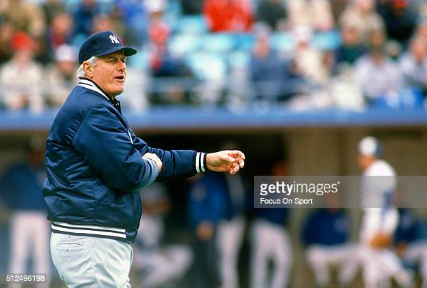 Manager Dallas Green of the New York Yankees signals the bullpen to make a pitching change against the Toronto Blue Jays during a Major League...