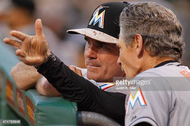 Manager Dan Jennings of the Miami Marlins talks with third base coach Brett Butler during the game against the Pittsburgh Pirates at PNC Park on May...