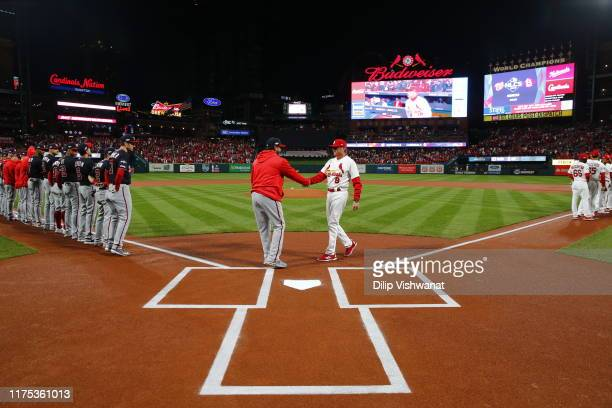 Manager Dave Martinez of the Washington Nationals and manager Mike Shildt of the St Louis Cardinals shake hands prior to Game 1 of the NLCS between...