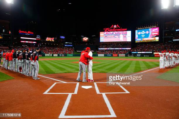 Manager Dave Martinez of the Washington Nationals and manager Mike Shildt of the St Louis Cardinals embrace prior to Game 1 of the NLCS between the...