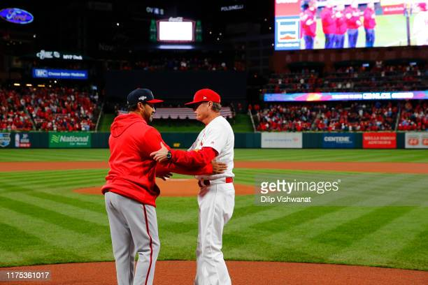 Manager Dave Martinez of the Washington Nationals and manager Mike Shildt of the St Louis Cardinals greet one another prior to Game 1 of the NLCS...