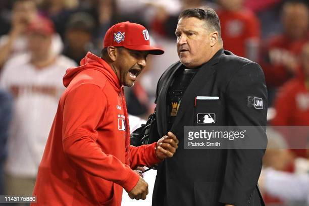 Manager Dave Martinez of the Washington Nationals argues with home plate umpire Tony Randazzo at the end of the fifth inning against the San...