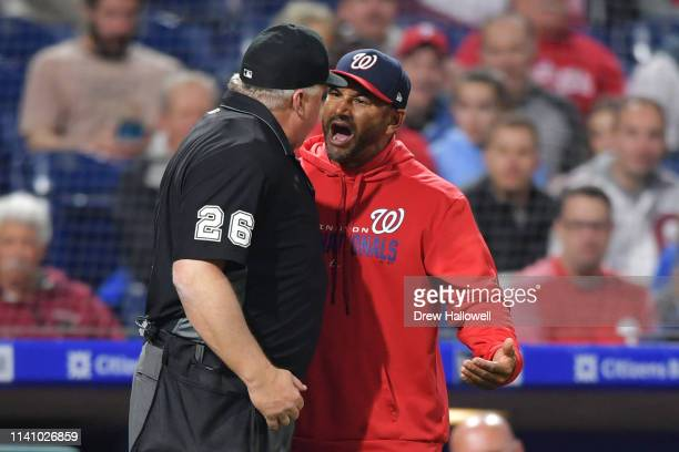 Manager Dave Martinez of the Washington Nationals argues with umpire Bill Miller in the fourth inning during the game against the Philadelphia...