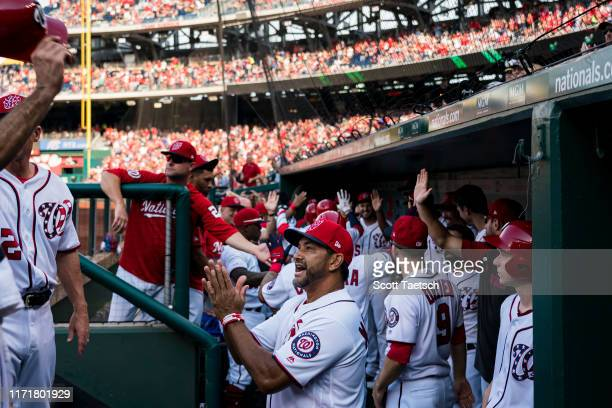 Manager Dave Martinez of the Washington Nationals celebrates with team members after Gerardo Parra hits a grand slam against the Cleveland Indians...