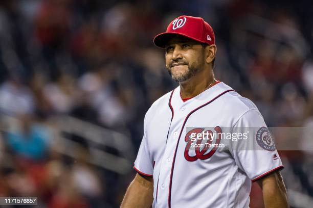 Manager Dave Martinez of the Washington Nationals looks on against the Philadelphia Phillies during the eighth inning at Nationals Park on September...