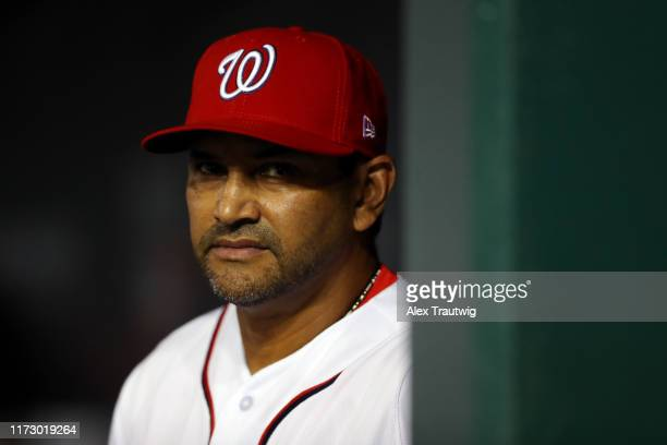 Manager Dave Martinez of the Washington Nationals looks on during the NL Wild Card game between the Milwaukee Brewers and the Washington Nationals at...