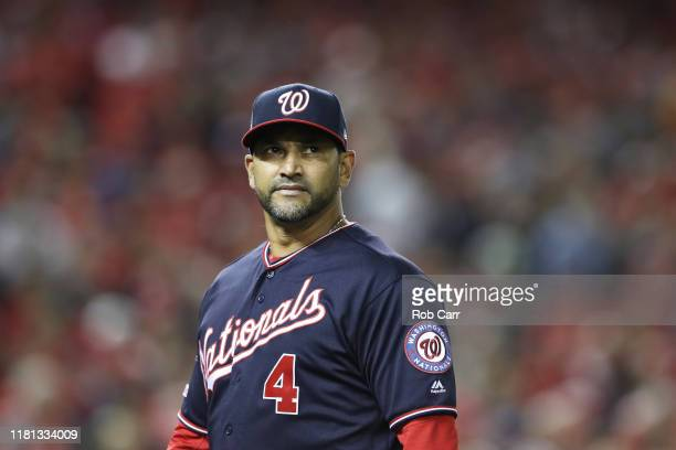 Manager Dave Martinez of the Washington Nationals looks on in the eighth inning against the St Louis Cardinals during game four of the National...