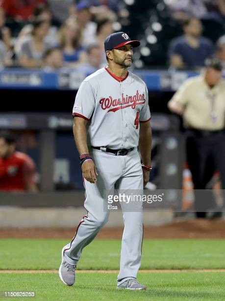 Manager Dave Martinez of the Washington Nationals pulls Joe Ross from the game in the eighth inning against the New York Mets at Citi Field on May 20...