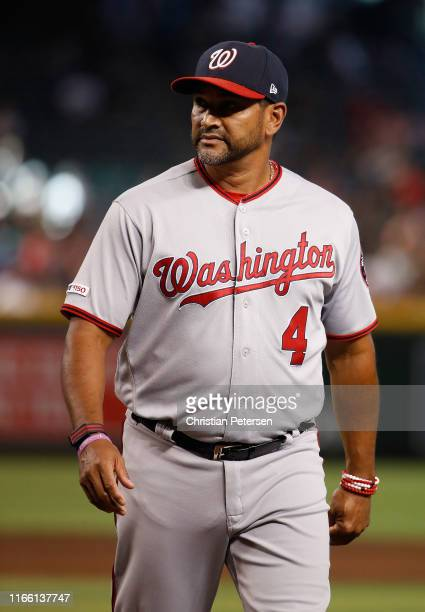 Manager Dave Martinez of the Washington Nationals walks off the field during the MLB game against the Arizona Diamondbacks at Chase Field on August...