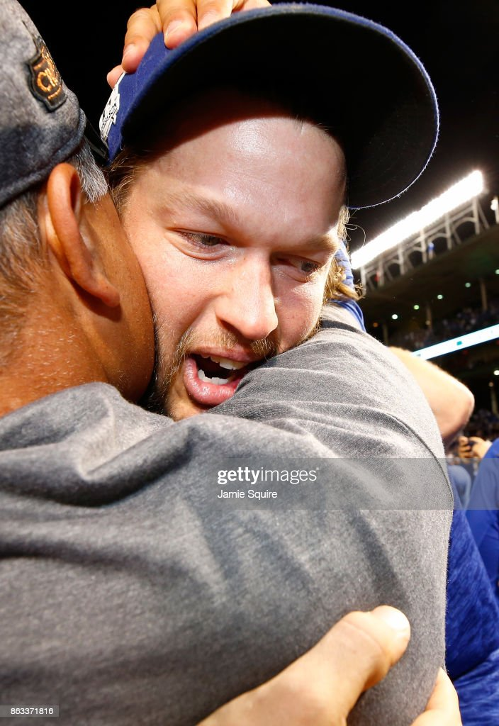 Manager Dave Roberts and Clayton Kershaw #22 of the Los Angeles Dodgers celebrate after beating the Chicago Cubs 11-1 in game five of the National League Championship Series at Wrigley Field on October 19, 2017 in Chicago, Illinois. The Dodgers advance to the 2017 World Series.