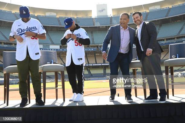 Manager Dave Roberts and general manager Andrew Friedman on as the newly acquired Los Angeles Dodgers Mookie Betts and David Price are introduced at...