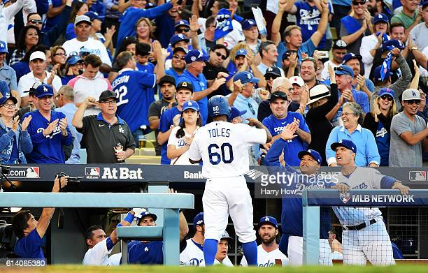 Manager Dave Roberts celebrates with Andrew Toles of the Los Angeles Dodgers in the eighth inning after Toles scored on a single by Chase Utley...