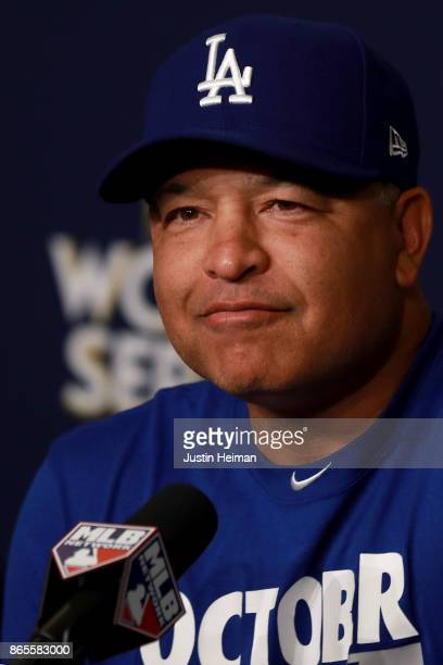 Manager Dave Roberts of the Los Angeles Dodgers answers questions from the media ahead of the World Series at Dodger Stadium on October 23 2017 in...