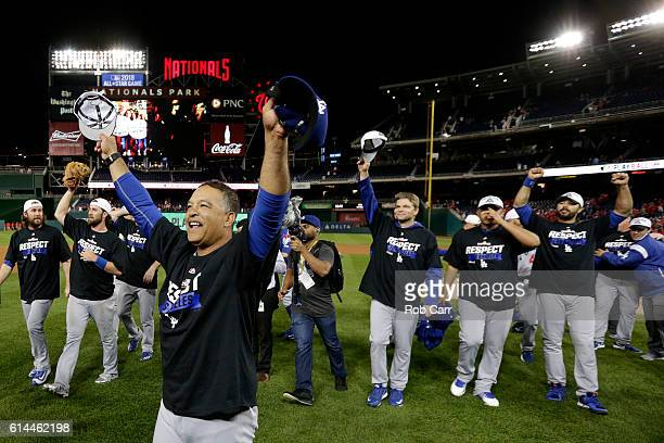 Manager Dave Roberts of the Los Angeles Dodgers celebrates after winning game five of the National League Division Series over the Washington...
