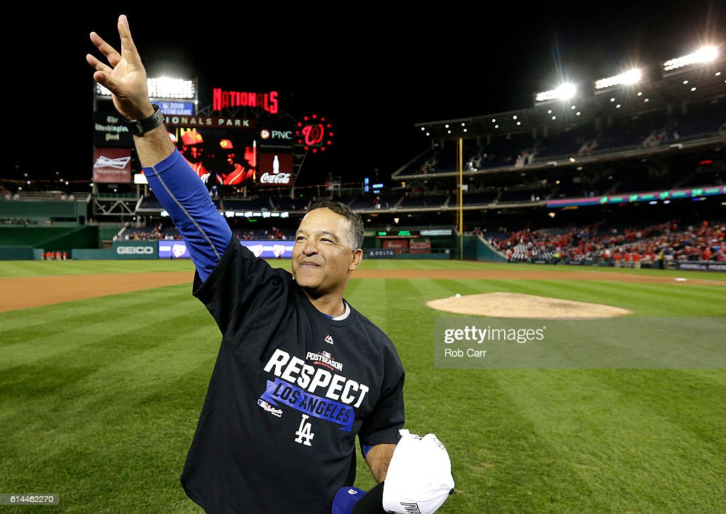 Manager Dave Roberts #30 of the Los Angeles Dodgers celebrates after winning game five of the National League Division Series over the Washington Nationals 4-3 at Nationals Park on October 13, 2016 in Washington, DC.