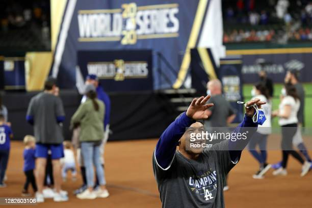 Manager Dave Roberts of the Los Angeles Dodgers celebrates after defeating the Tampa Bay Rays 3-1 in Game Six to win the 2020 MLB World Series at...