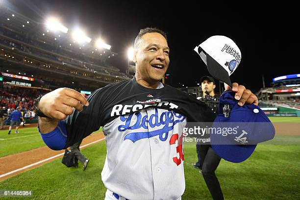 Manager Dave Roberts of the Los Angeles Dodgers celebrates on the field after defeating the Washington Nationals 43 in Game 5 of NLDS at Nationals...