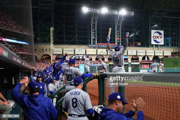 Manager Dave Roberts of the Los Angeles Dodgers celebrates with his team in the dugout after a threerun home run by Cody Bellinger during the fifth...