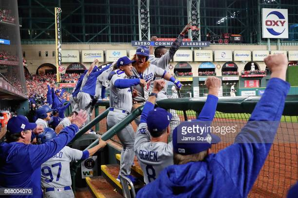 Manager Dave Roberts of the Los Angeles Dodgers celebrates with his team as the tying run is scored during the ninth inning against the Houston...
