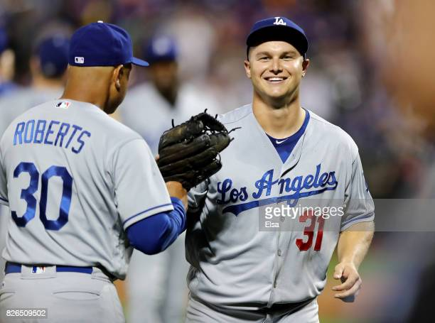 NEW YORK NY AUGUST Manager Dave Roberts of the Los Angeles Dodgers congratulates Joc Pederson after Pederson made the catch for the final out of the...