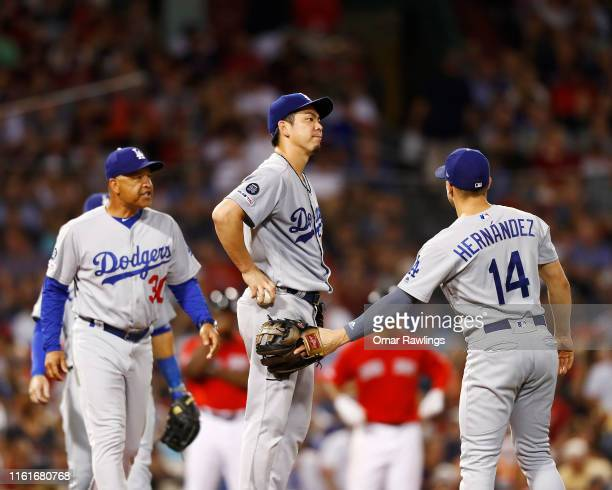 Manager Dave Roberts of the Los Angeles Dodgers pulls starting pitcher Kenta Maeda of the Los Angeles Dodgers in the bottom of the sixth inning of...