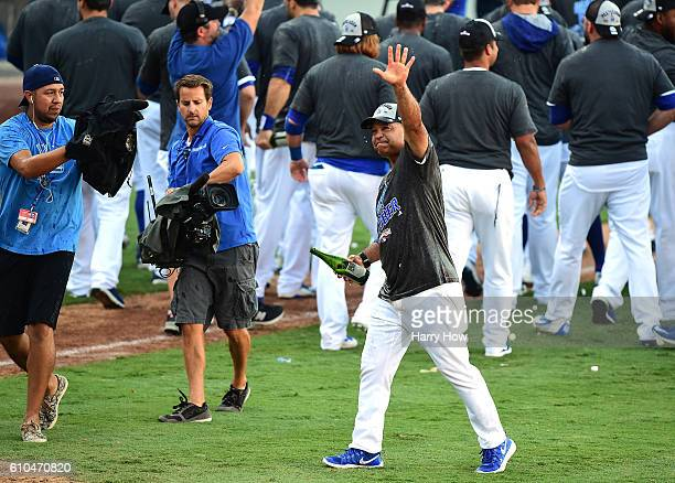 Manager Dave Roberts of the Los Angeles Dodgers reacts after a 43 win over the Colorado Rockies to clinch the National League West Division at Dodger...