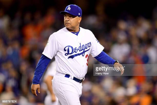 Manager Dave Roberts of the Los Angeles Dodgers returns to the dugout after pulling Brandon Morrow during the sixth inning in game six of the 2017...