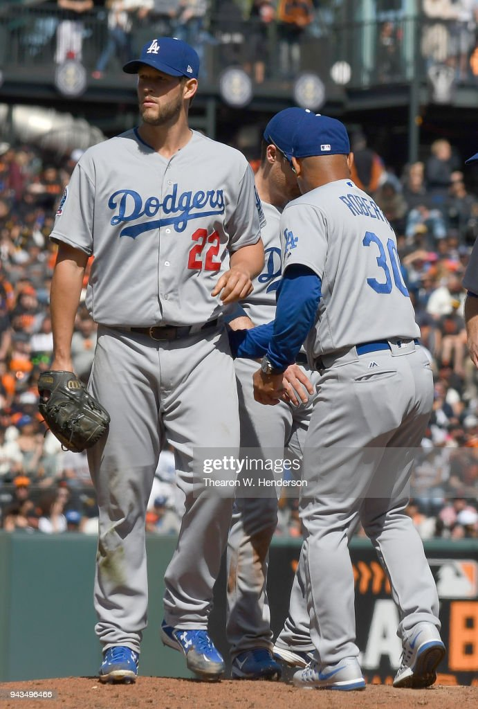 Manager Dave Roberts #30 of the Los Angeles Dodgers takes the ball from Clayton Kershaw #22 taking him out of the game against the San Francisco Giants in the bottom of the eighth inning at AT&T Park on April 8, 2018 in San Francisco, California.