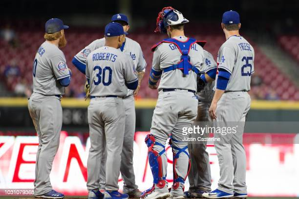 Manager Dave Roberts of the Los Angeles Dodgers talks to his team in the fourth inning against the Cincinnati Reds at Great American Ball Park on...