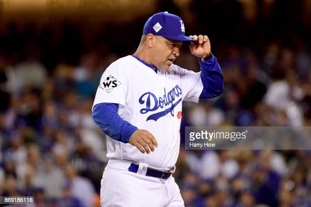 Manager Dave Roberts of the Los Angeles Dodgers visits the pitcher's mound during the sixth inning against the Houston Astros in game seven of the...