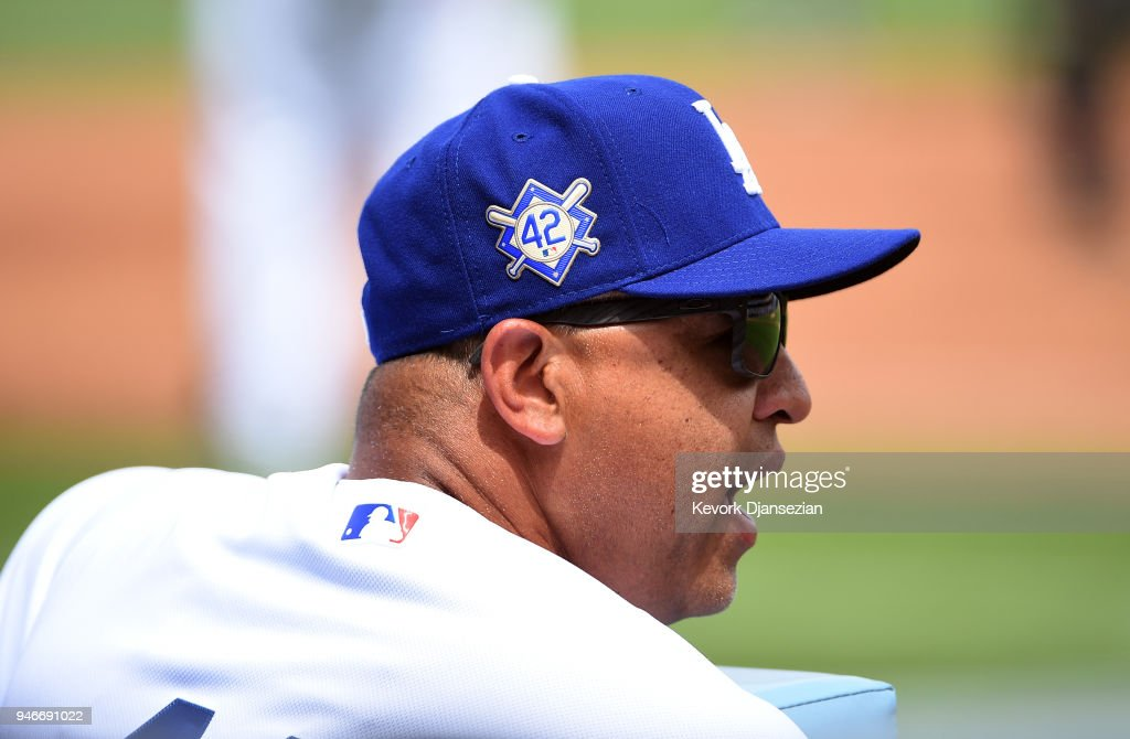 Manager Dave Roberts #30 of the Los Angeles Dodgers yells instructions from the dugout during the second inning against Arizona Diamondbacks at Dodger Stadium on April 15, 2018 in Los Angeles, California.