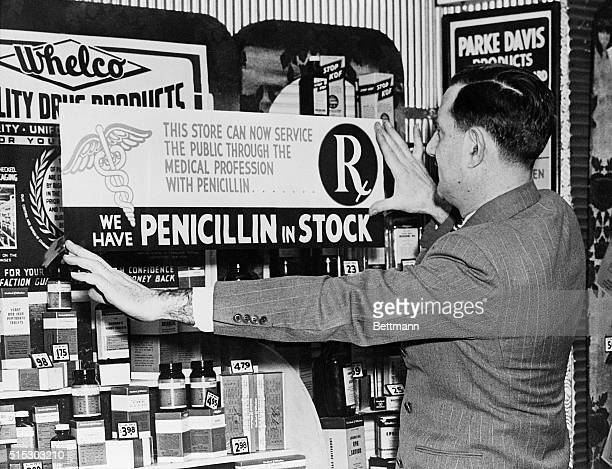 Manager Dave Tarlow of Whalen's Drug Store 55 E 42nd Street is shown putting up a sign advertising the fact that they now have the wonder drug...