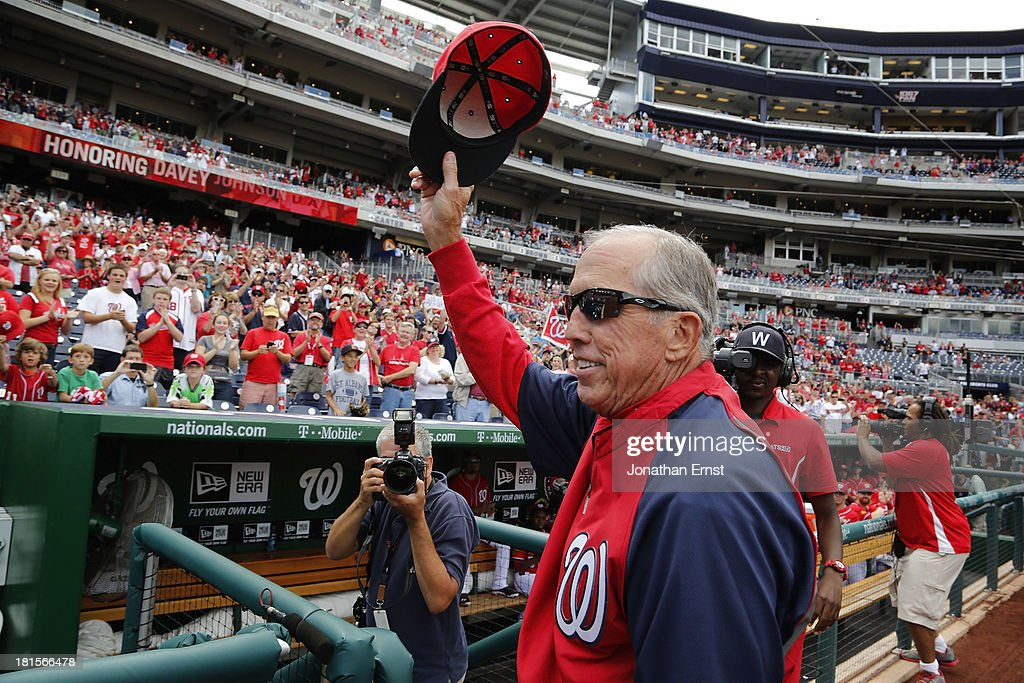 Manager Davey Johnson of the Washington Nationals doffs his hat to the crowd as he is honored on the field prior to his final regular-season home games, a day-night doubleheader against the Miami Marlins, at Nationals Park on September 22, 2013 in Washington, DC.