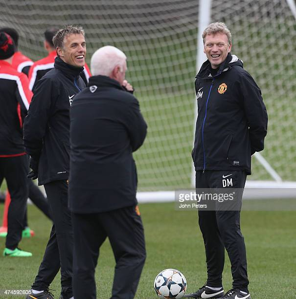 Manager David Moyes and Coach Phil Neville of Manchester United in action during a first team training session ahead of their UEFA Champions League...