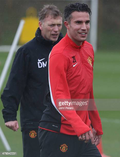 Manager David Moyes and Robin van Persie of Manchester United in action during a first team training session ahead of their UEFA Champions League...