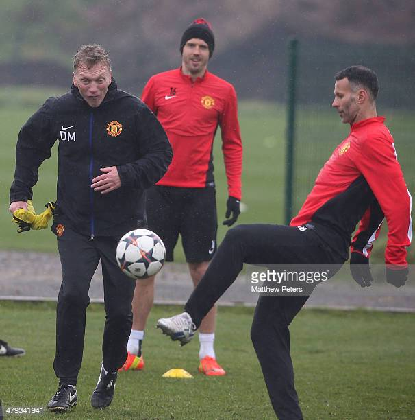 Manager David Moyes and Ryan Giggs of Manchester United in action during a first team training session ahead of their UEFA Champions League Round of...