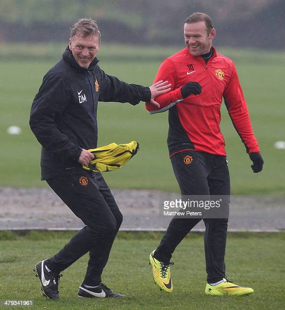 Manager David Moyes and Wayne Rooney of Manchester United in action during a first team training session ahead of their UEFA Champions League Round...
