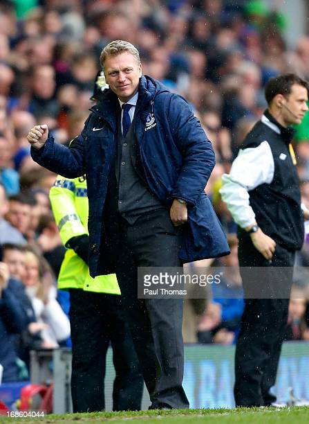 Manager David Moyes of Everton celebrates his teams first goal during the Barclays Premier League match between Everton and West Ham United at...