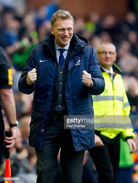 Manager David Moyes of Everton celebrates his team's second goal during the Barclays Premier League match between Everton and West Ham United at...