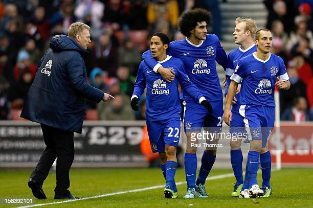 Manager David Moyes of Everton speaks to his player Steven Pienaar as he celebrates his goal with Everton team mates during the Barclays Premier...