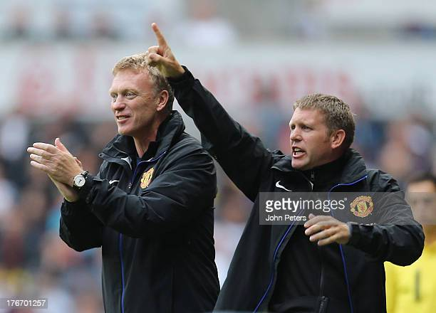 Manager David Moyes of Manchester United celebrates Robin van Persie scoring their third goal during the Barclays Premier League match between...