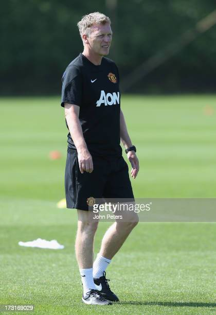 Manager David Moyes of Manchester United in action during a first team training session at the Aon Training Complex on July 9, 2013 in Manchester,...