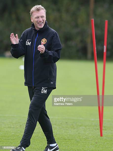 Manager David Moyes of Manchester United in action during a first team training session, ahead of their UEFA Champions League match against Bayer...