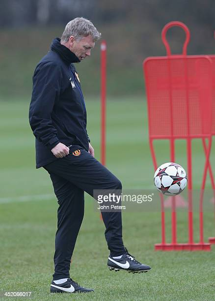 Manager David Moyes of Manchester United in action during a first team training session ahead of their UEFA Champions League Group A match against...