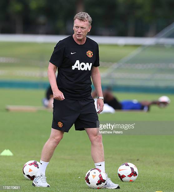 Manager David Moyes of Manchester United oversees a first team training session at Royal Bangkok Sports Club as part of their preseason tour to...